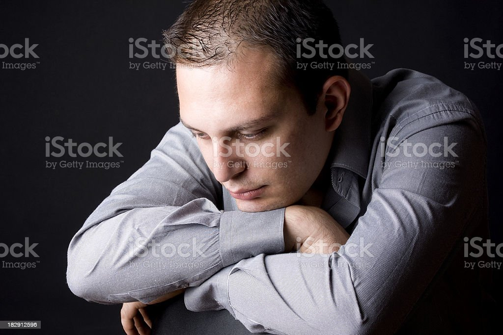 Young businessman contemplating royalty-free stock photo