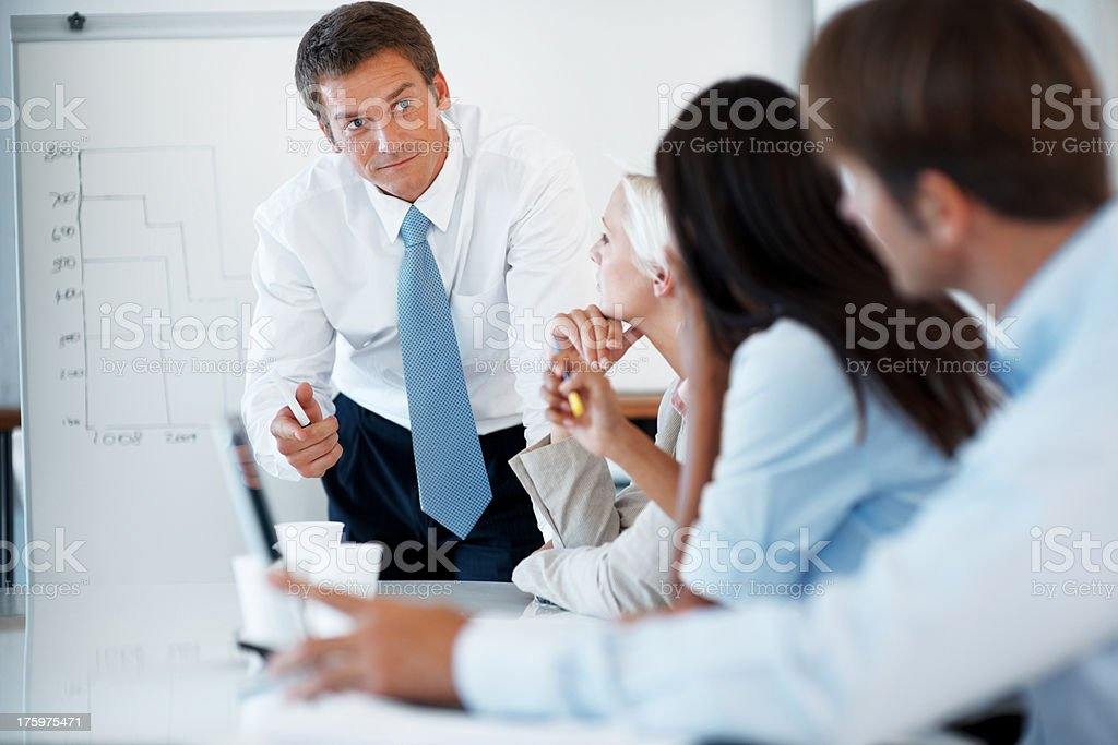 Young businessman discussing working ideas with colleagues stock photo