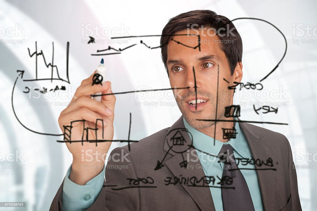 Young Businessman Drawing A Diagram royalty-free stock photo