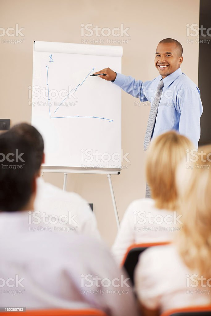 Young businessman drawing a graph. royalty-free stock photo
