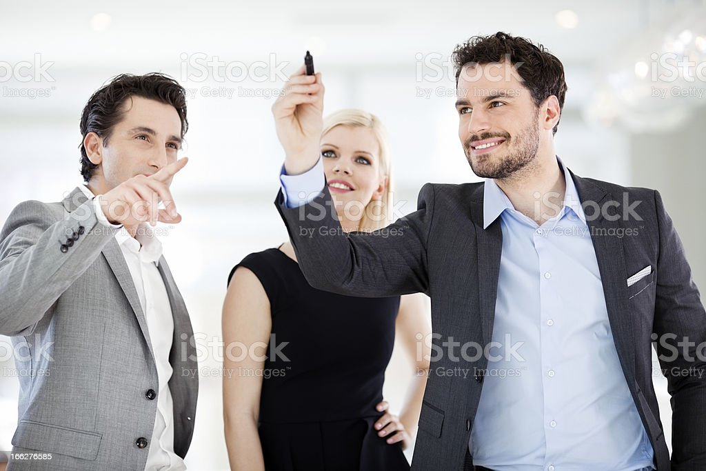 Young businessman drawing on empty  virtual screen,window. royalty-free stock photo