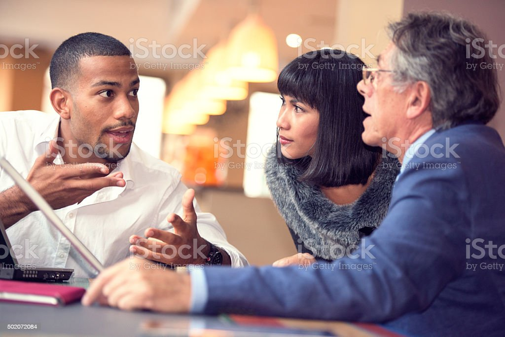Young businessman explaining his business proposal stock photo