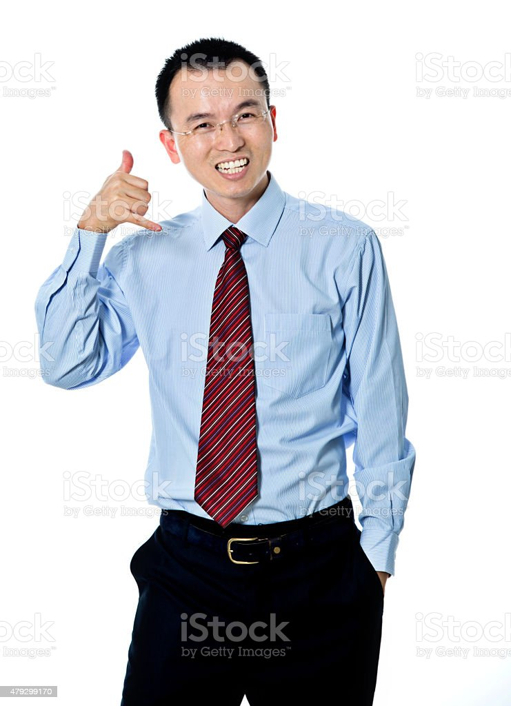 Young businessman gesturing call sign stock photo