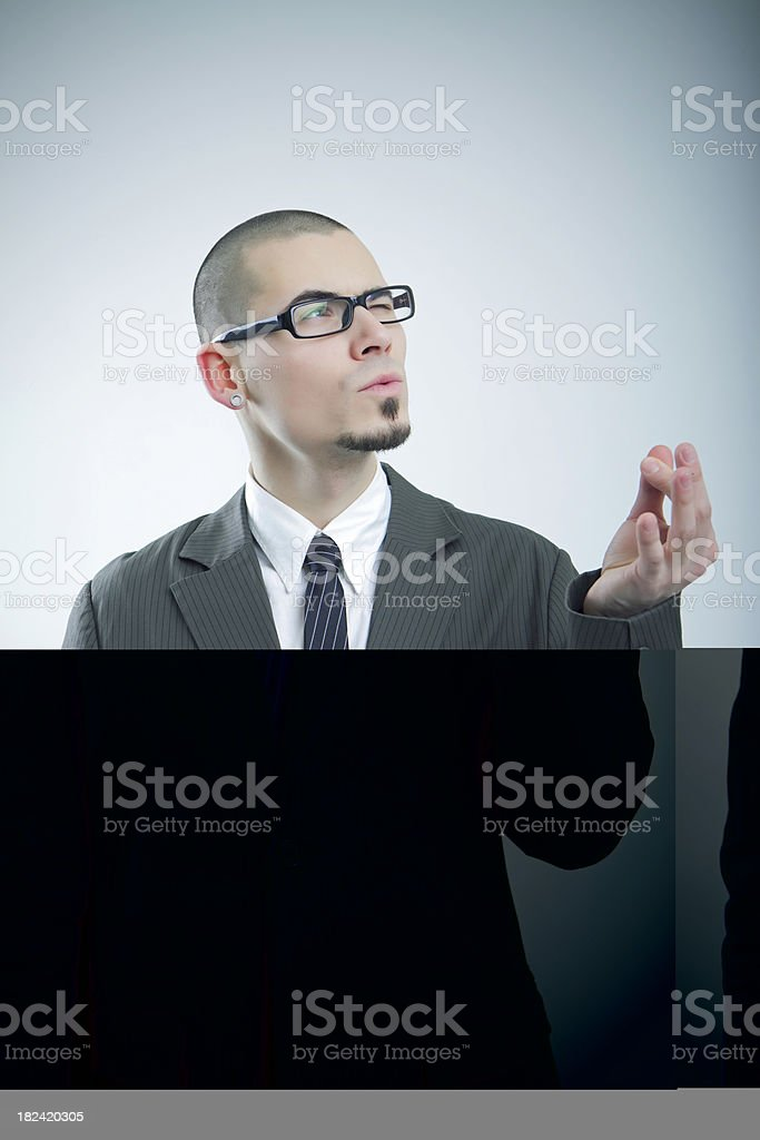 Young businessman giving a finger royalty-free stock photo