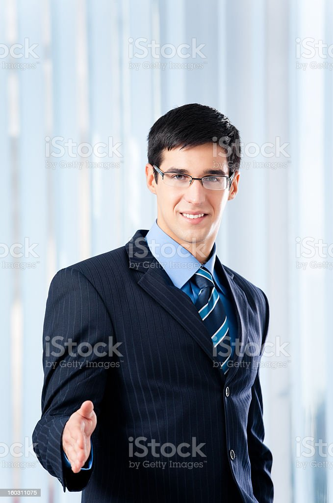 Young businessman giving hand for handshake royalty-free stock photo