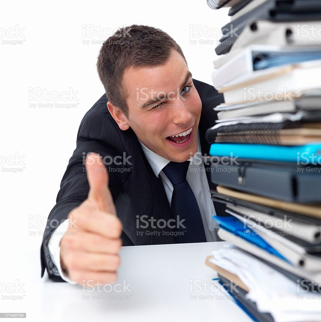 Young businessman giving thumbs up royalty-free stock photo