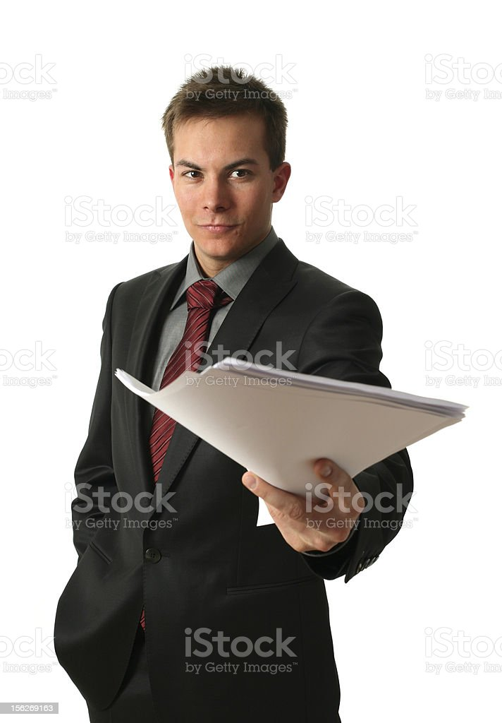 Young businessman handing over documents royalty-free stock photo