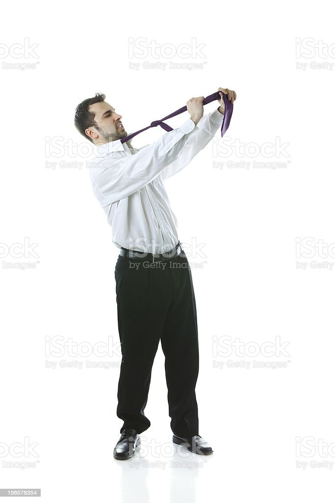 Young businessman hanging himself royalty-free stock photo