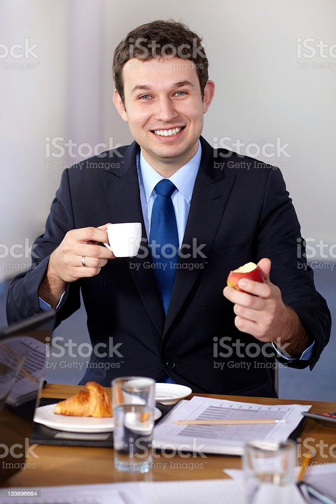 Young businessman having a break during meeting royalty-free stock photo