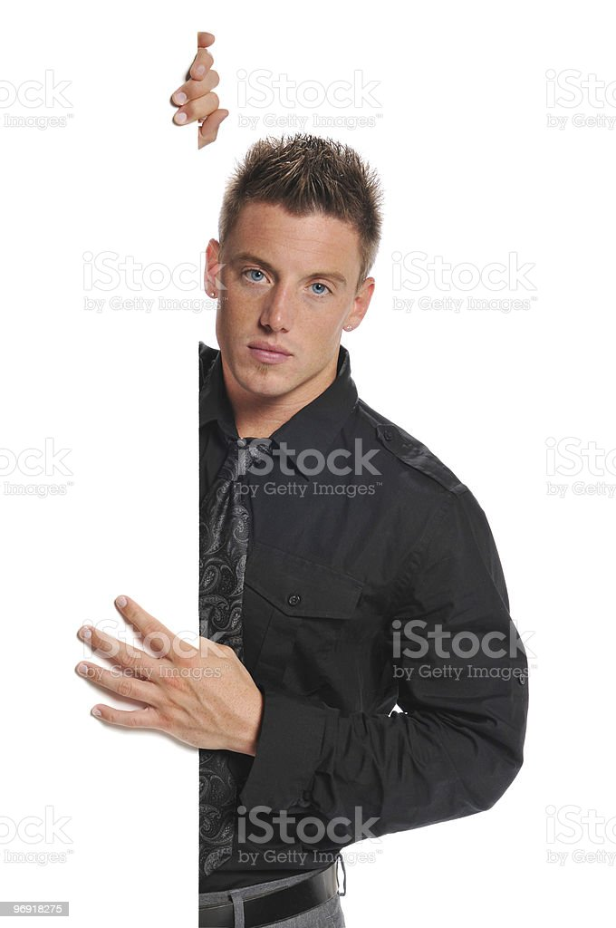 Young businessman holding blank sign royalty-free stock photo
