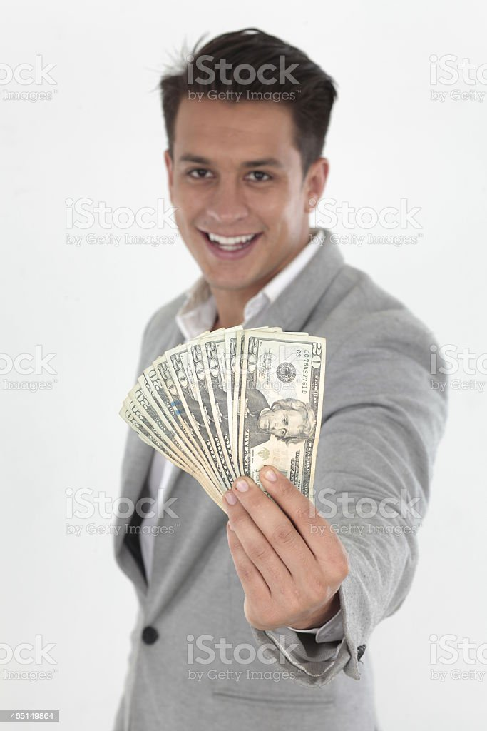 Young businessman holding cash in his hand stock photo