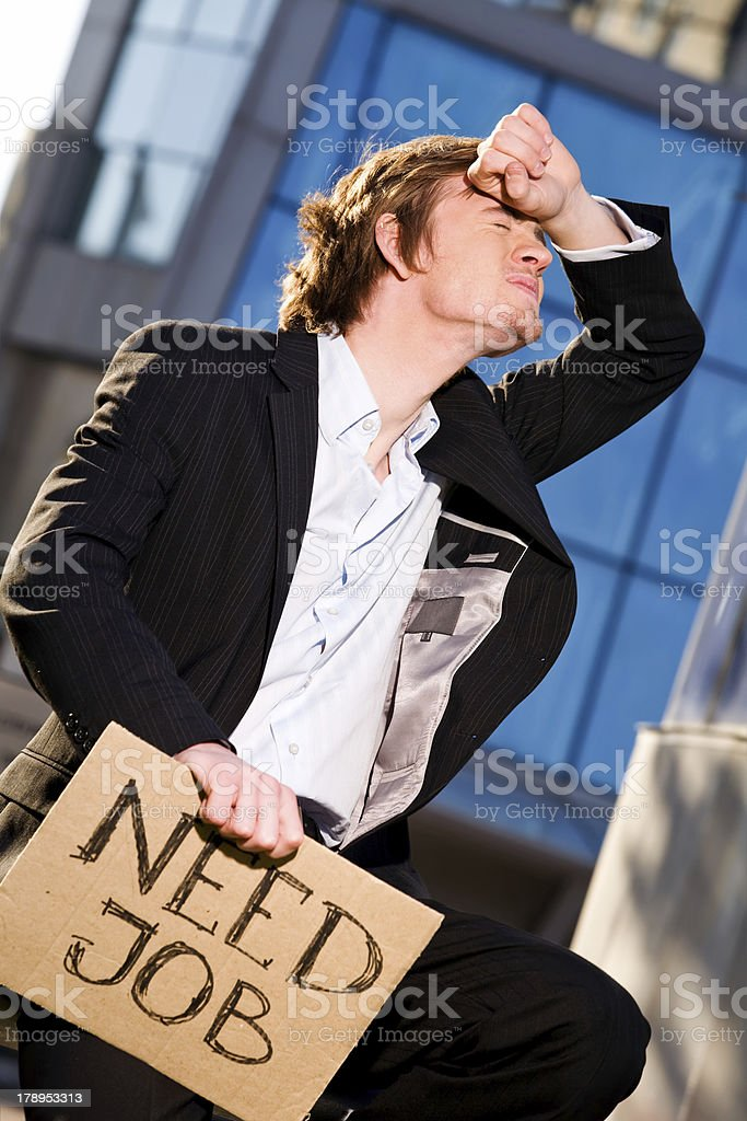 Young businessman holding sign Need Job outdoors royalty-free stock photo