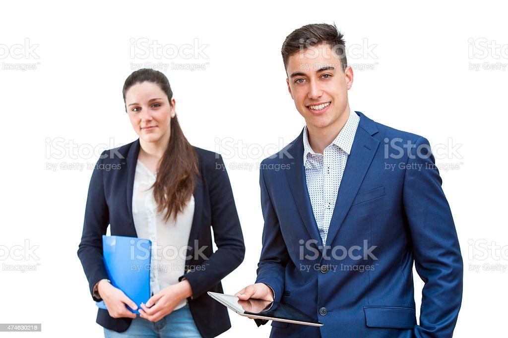 Jeune homme d'affaires en tenant une tablette avec un partenaire féminin backgrou photo libre de droits