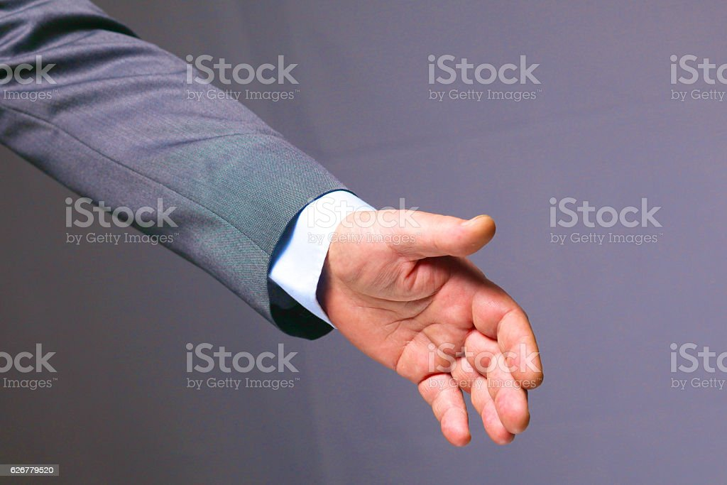 young businessman holds out his hand with a business card stock photo