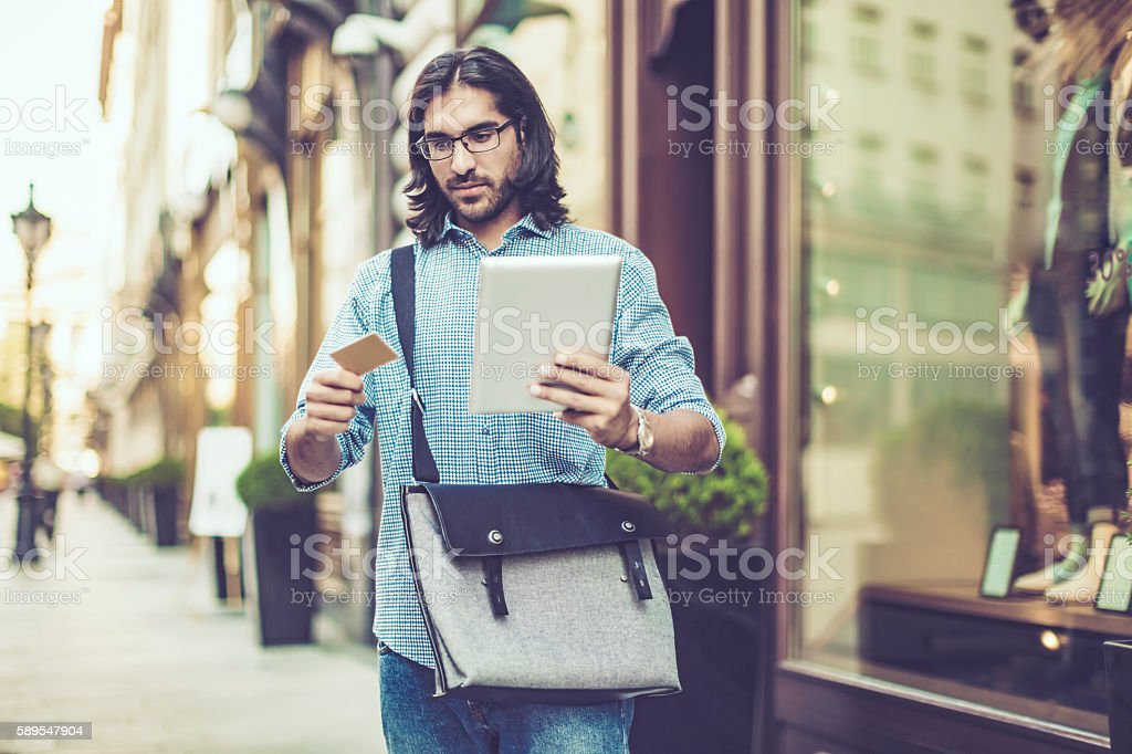 Young businessman in a city stock photo