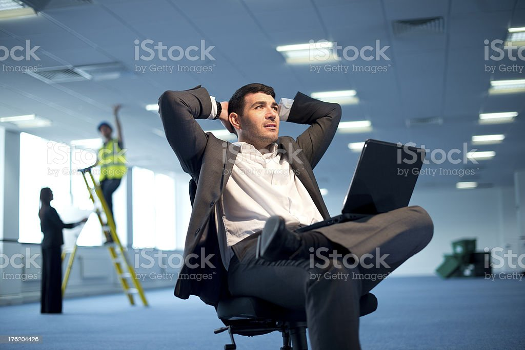 young businessman in empty office royalty-free stock photo