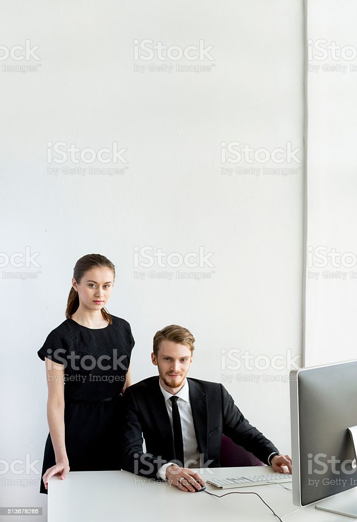 Young Businessman In Office With His Female Employee stock photo