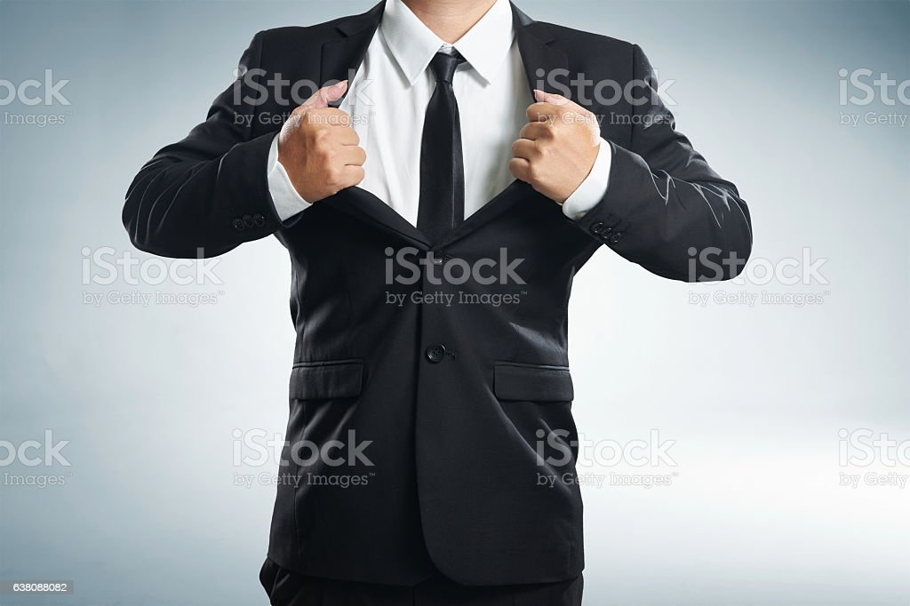 Young businessman in superhero action with black suit stock photo