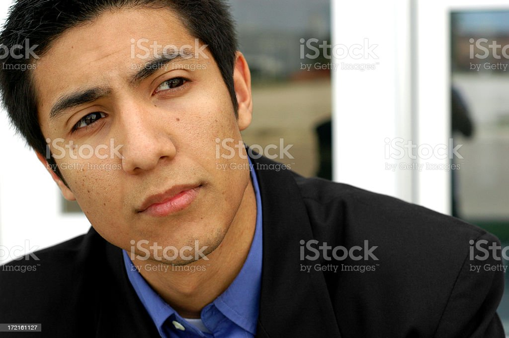 Young Businessman in Thought stock photo