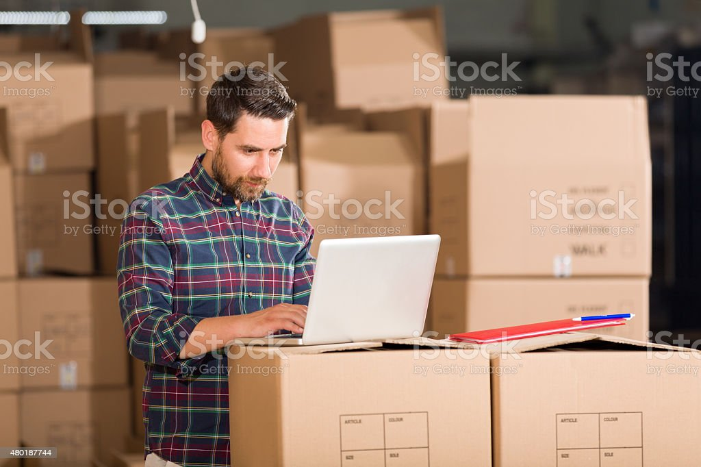 Young Businessman in Warehouse stock photo