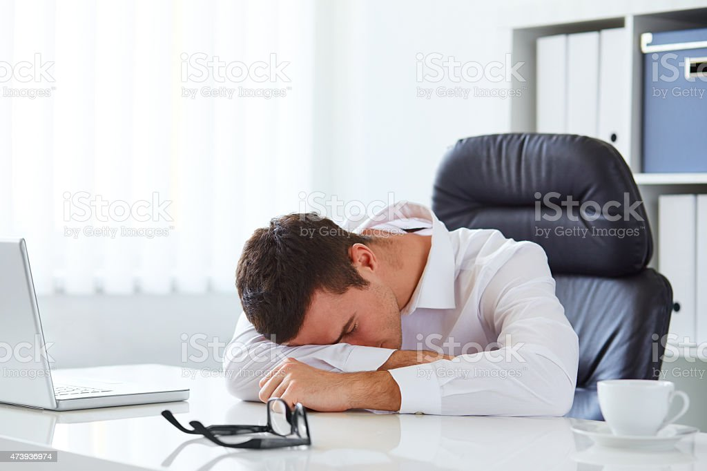 Young businessman in white shirt sleeping stock photo