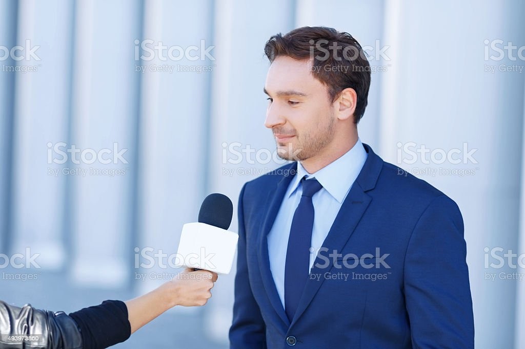 Young businessman is being interviewed stock photo