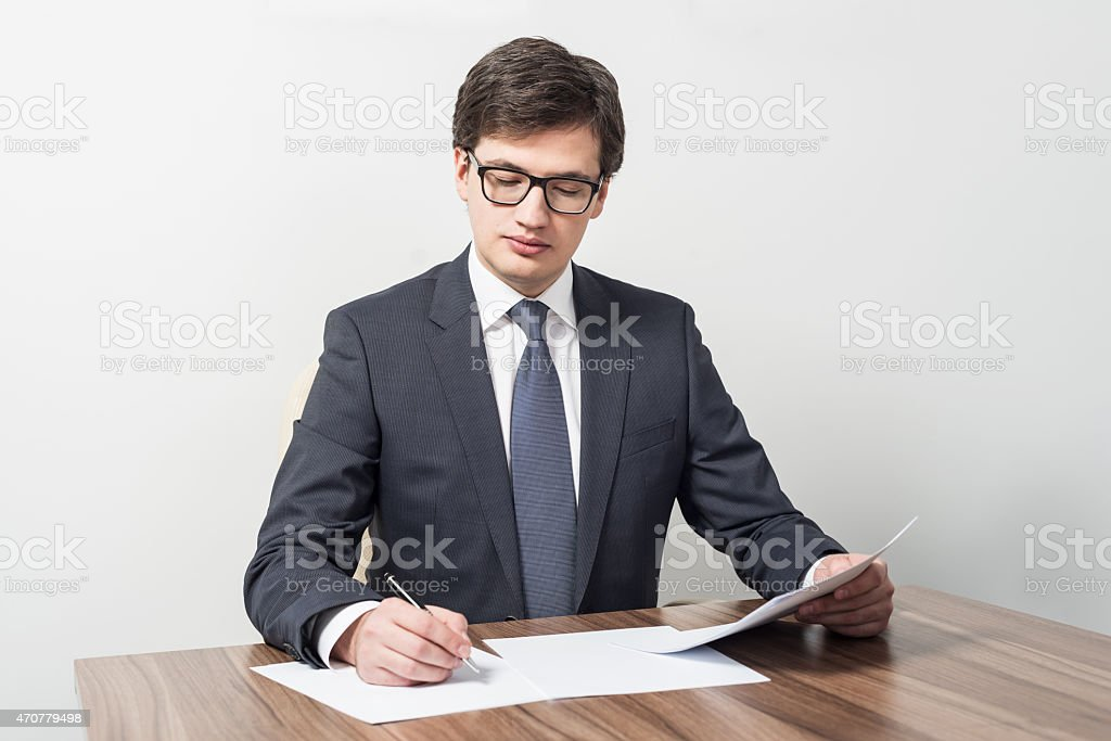 Young businessman is checking contracts stock photo