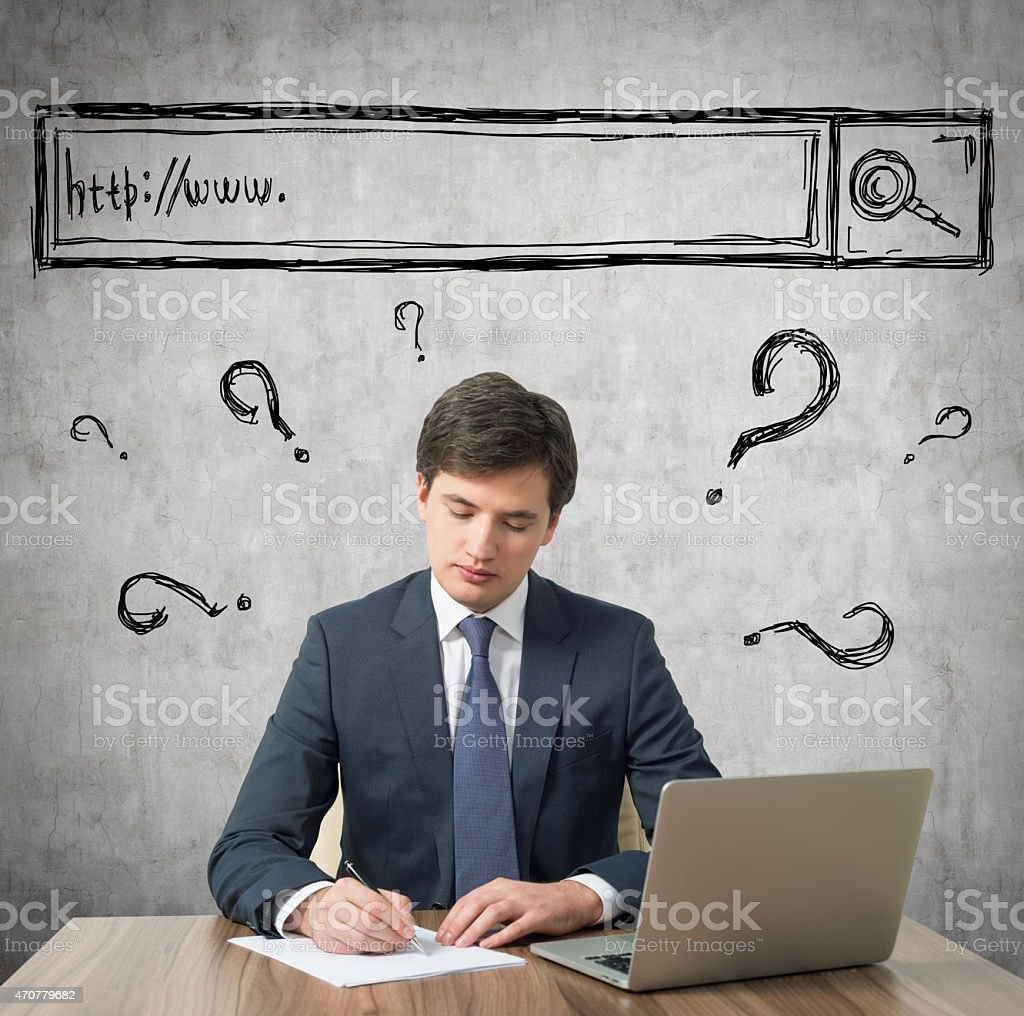 Young businessman is developing a new IT start up project. stock photo