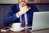 Young businessman is shopping online