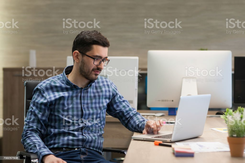 Young businessman is working on his laptop in office stock photo