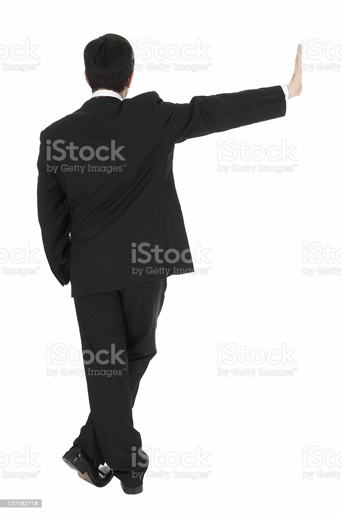 Young businessman leaning on the wall royalty-free stock photo