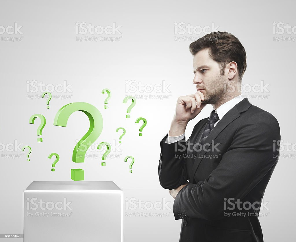 Young  businessman look at the green question marks royalty-free stock photo