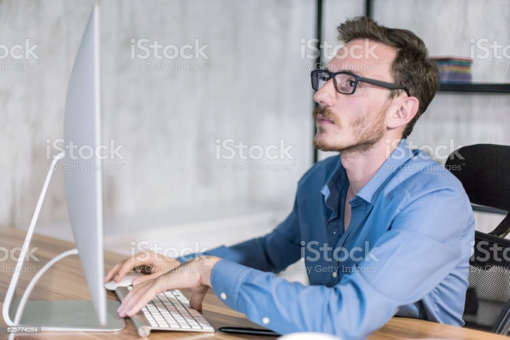 Young Businessman  Looking at monitor stock photo