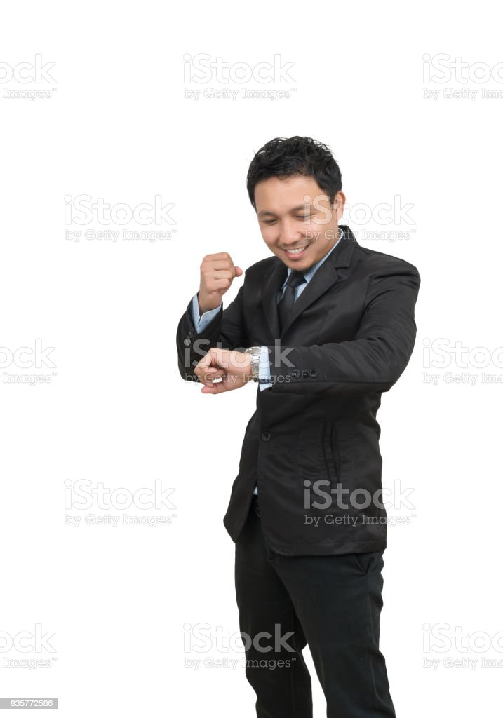 Young businessman looking at watch which cheerful action on white background, include clipping path stock photo