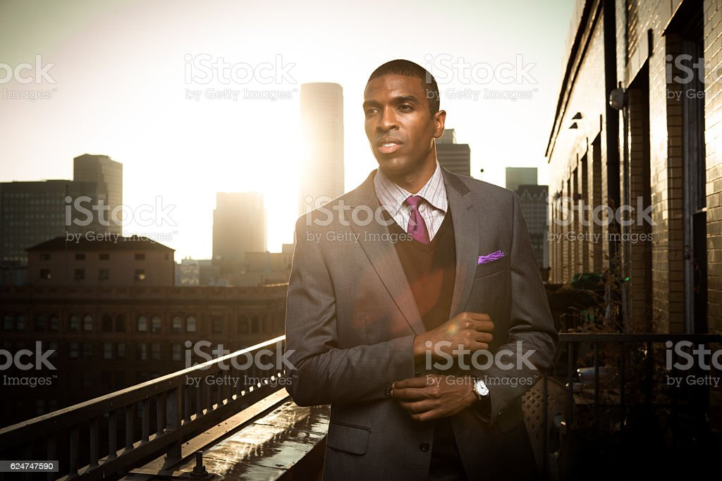 Young Businessman Looking into Distance stock photo