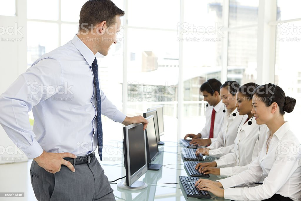 Young businessman managing an international call center royalty-free stock photo