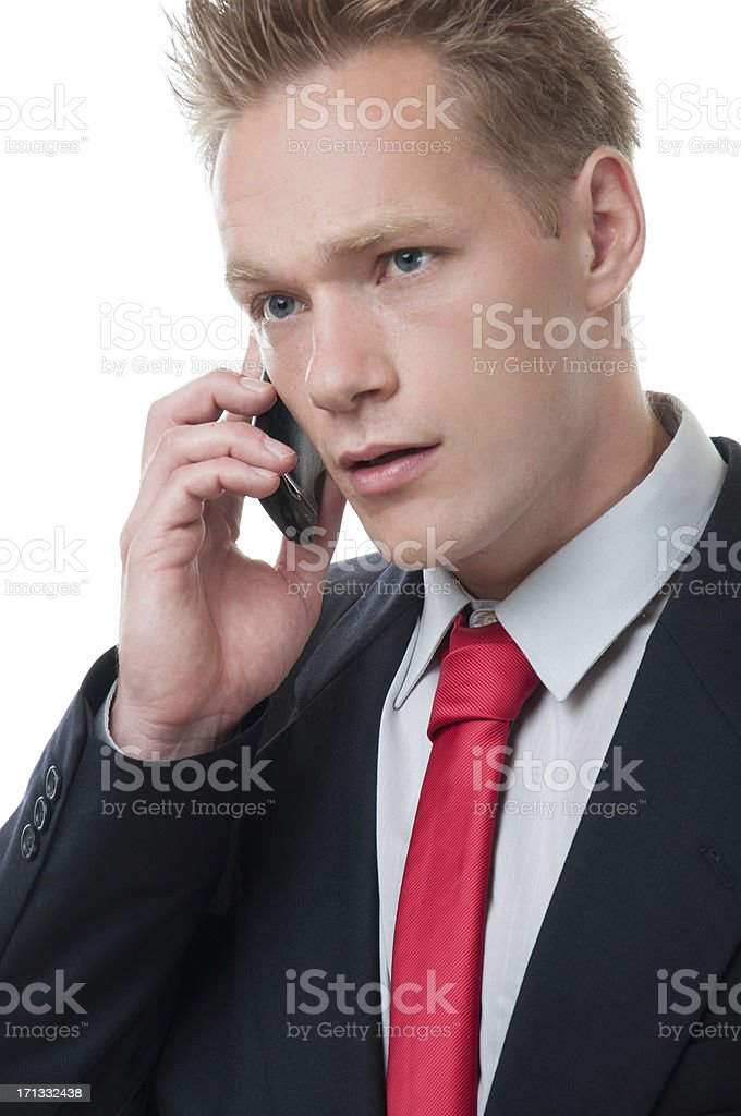 Young businessman on mobile phone stock photo