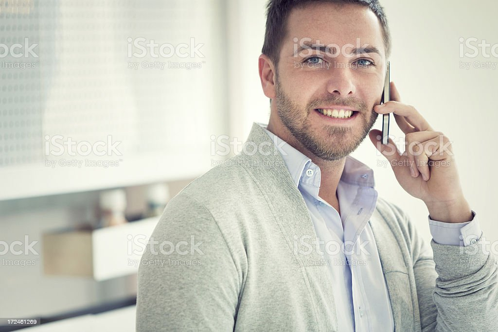 Young businessman on the phone for business stock photo