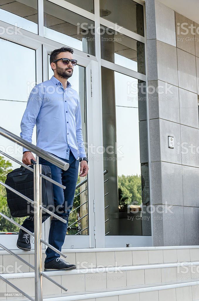 Young businessman or lawyer enters the building or workplace stock photo