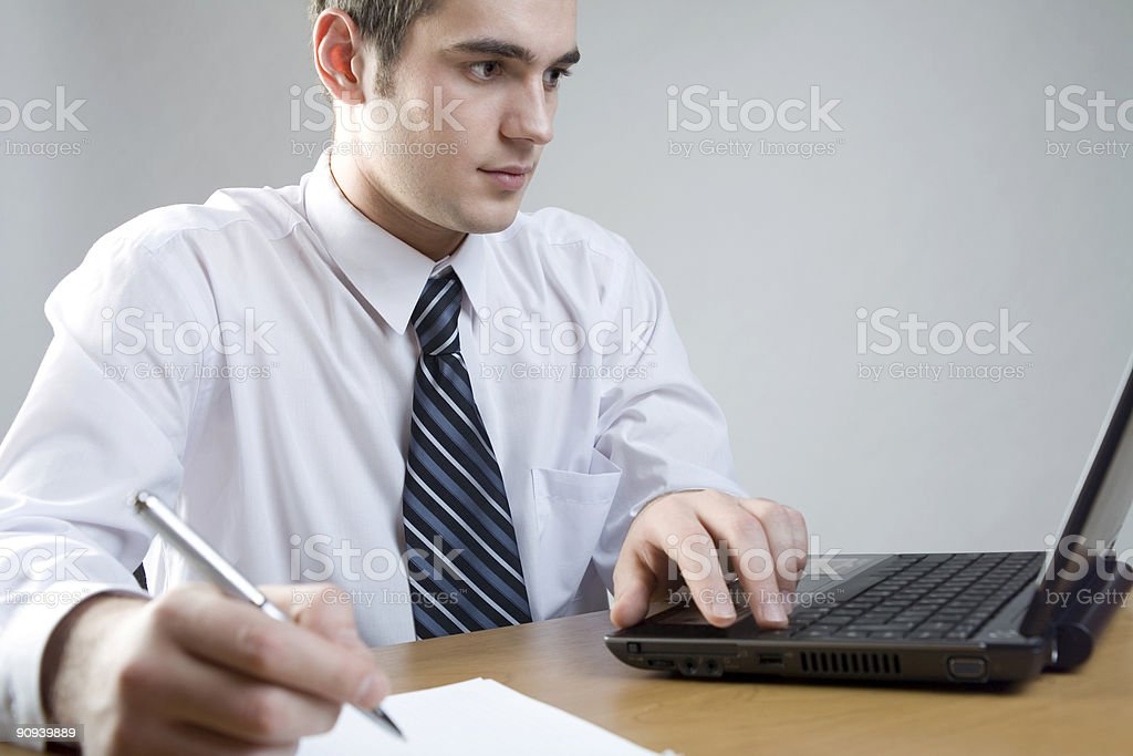 Young businessman or student at the table with laptop royalty-free stock photo