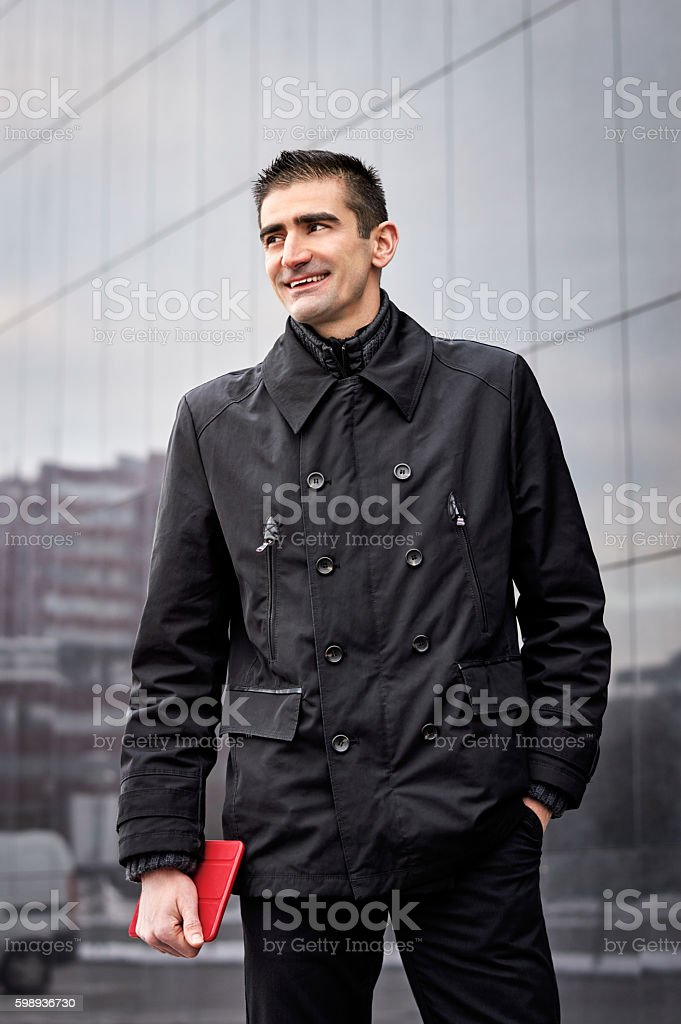 Young businessman outside office building stock photo