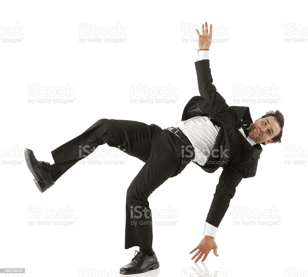 Young businessman performing a cartwheel royalty-free stock photo