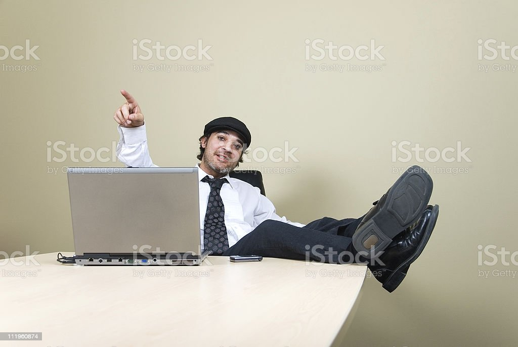 Young businessman poing and talking to someone in the office stock photo