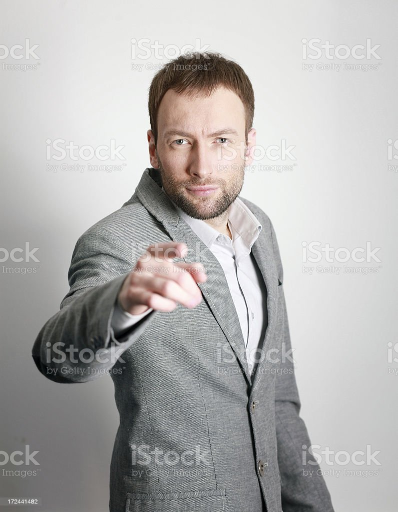 Young businessman pointing at you stock photo