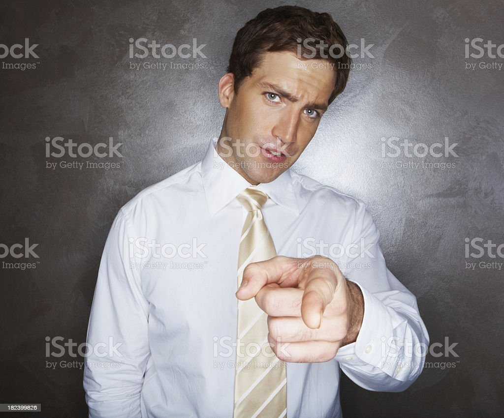Young businessman pointing at you royalty-free stock photo