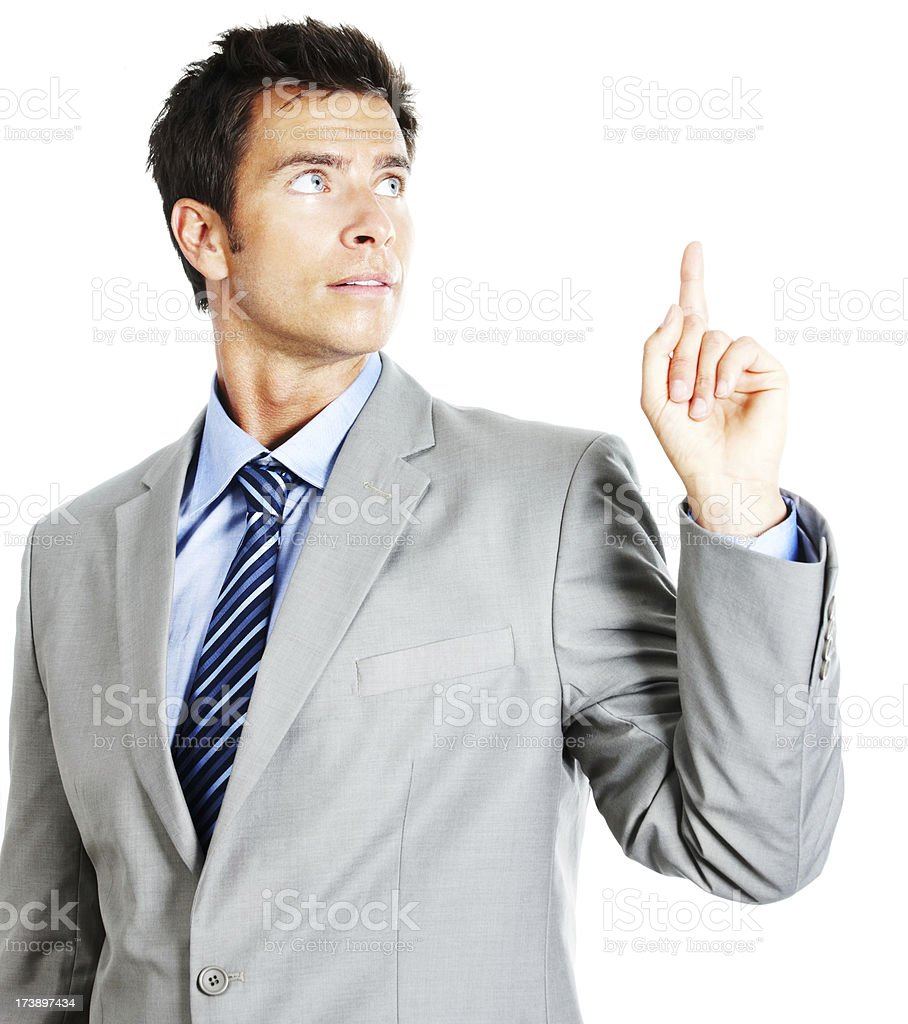 Young businessman pointing up royalty-free stock photo