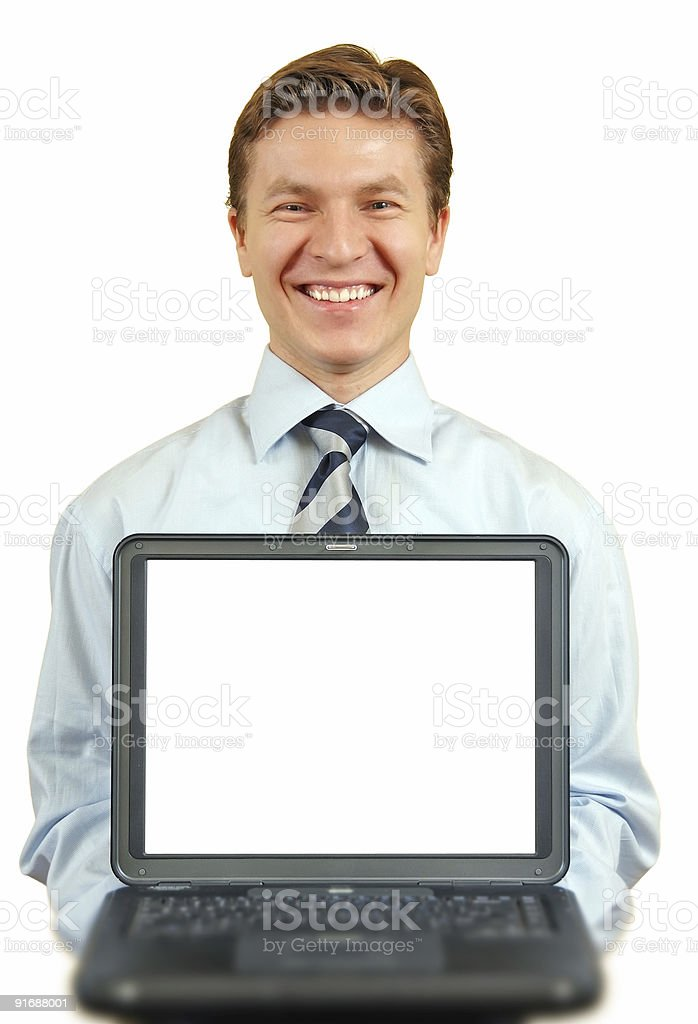 Young businessman presenting a laptop ,screen with clipping path royalty-free stock photo