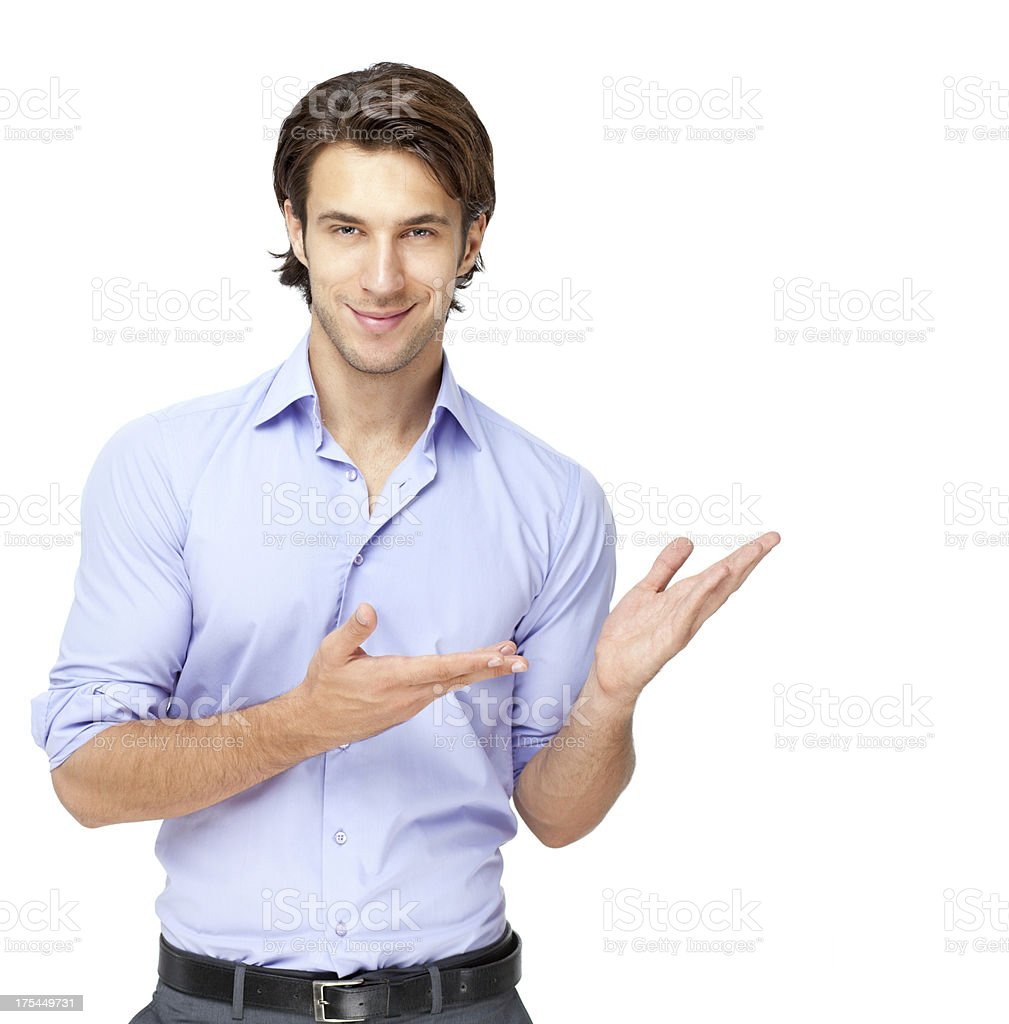 young businessman presenting over white background royalty-free stock photo