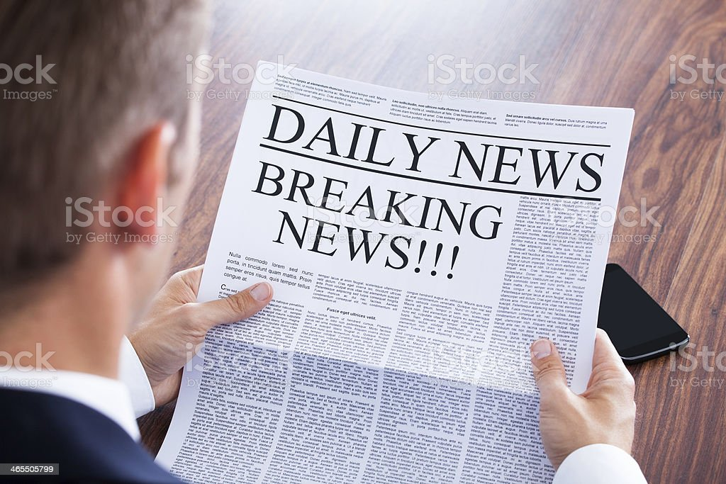 Young Businessman Reading Breaking News stock photo