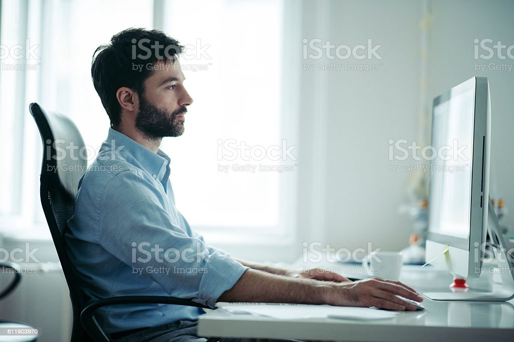 Young businessman reading mail stock photo